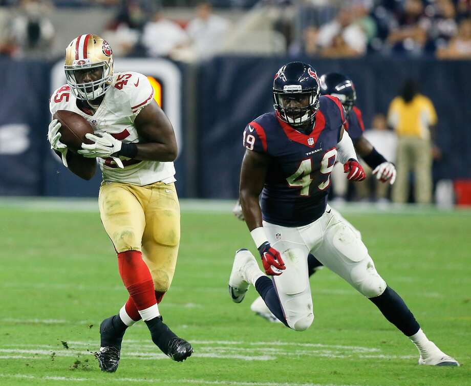 Asante Cleveland of the San Francisco 49ers makes a catch against the Houston Texans last weekend. Cleveland has been traded to the Patriots for offensive lineman Jordan Devey. Photo: Bob Levey, Getty Images