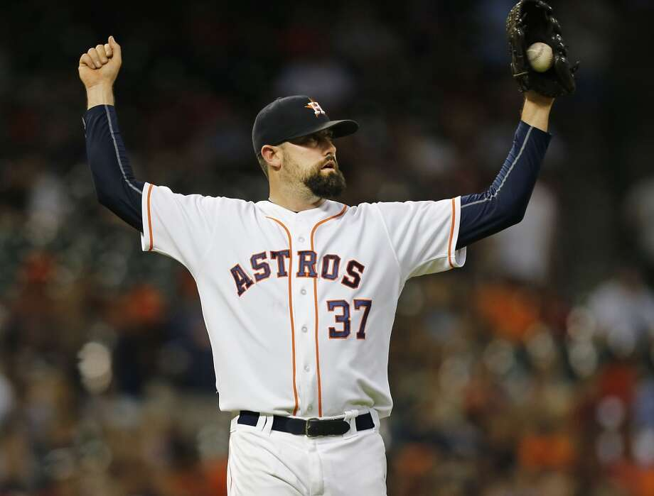 Astros reliever Pat Neshek pitched throughout 2015 with a fracture in his right foot that required surgery after the season.Click through the gallery for photos from the first day of spring training. Photo: James Nielsen, Houston Chronicle