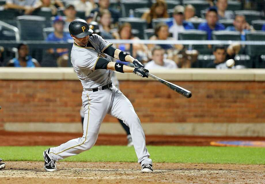NEW YORK, NY - AUGUST 15:  Pinch hitter Chris Stewart #19 of the Pittsburgh Pirates connects on a 14th inning RBI base hit against the New York Mets at Citi Field on August 15, 2015 in the Flushing neighborhood of the Queens borough of New York City.  (Photo by Jim McIsaac/Getty Images) ORG XMIT: 538590151 Photo: Jim McIsaac / 2015 Getty Images