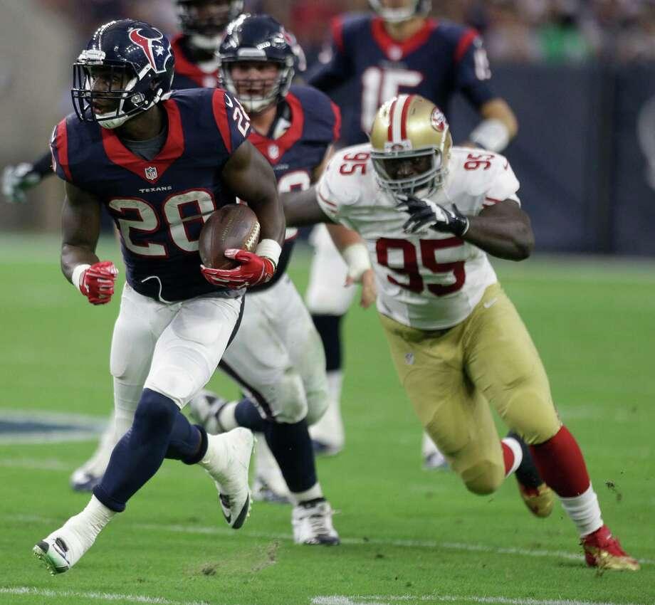Texans running back Alfred Blue  breaks away from 49ers defensive end Tank Carradine. Photo: Brett Coomer, Staff / © 2015  Houston Chronicle