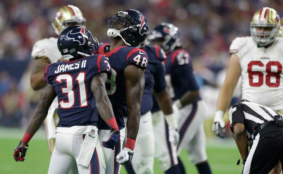 Texans defensive back Charles James, left, and linebacker Kourtnei Brown celebrate one of Brown's two sacks during Saturday night's 23-10 victory at NRG Stadium. Photo: Brett Coomer, Staff / © 2015  Houston Chronicle