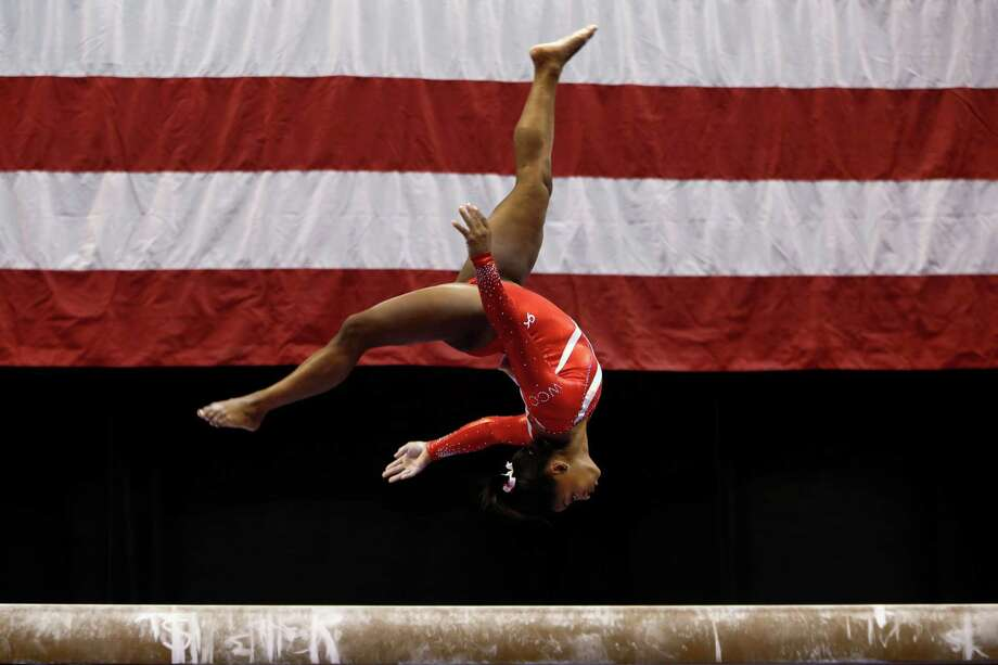 Simone Biles set aside recent struggles on the balance beam to put on a show Saturday night, earning a score of 15.9 en route to a third consecutive U.S. women's gymnastic championship. Photo: AJ Mast, FRE / FR123854 AP