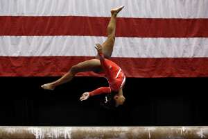 Simone Biles set aside recent struggles on the balance beam to put on a show Saturday night, earning a score of 15.9 en route to a third consecutive U.S. women's gymnastic championship.