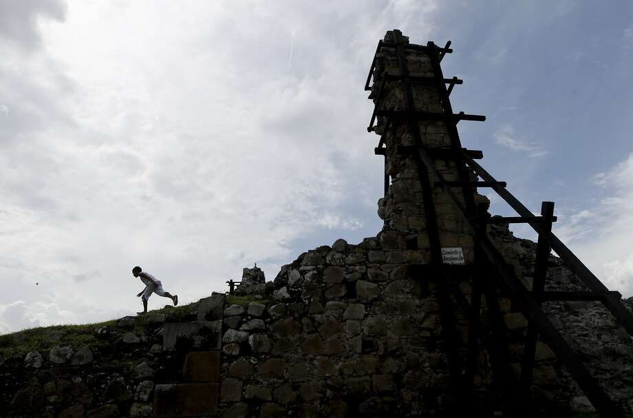 A boy runs among the ruins of Old Panama, in Panama City, Saturday, Aug. 15, 2015. Panama City was founded in 1519 and is celebrating its 496th anniversary this weekend. Photo: Arnulfo Franco, Associated Press