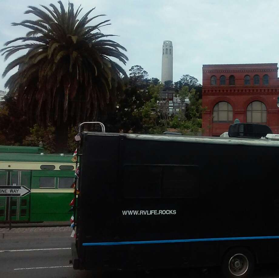 """Michael Salvato says life in an RV such as theirs (seen near Coit Tower) can have a """"green footprint"""" through the use of solar panels, batteries and nontoxic, biodegradable materials.  """"We use castile soap and don't use our black tank,"""" he adds. Photo: Amy Salvato"""
