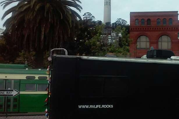 "Michael Salvato says life in an RV such as theirs (seen near Coit Tower) can have a ""green footprint"" through the use of solar panels, batteries and nontoxic, biodegradable materials. ""We use castile soap and don't use our black tank,"" he adds."