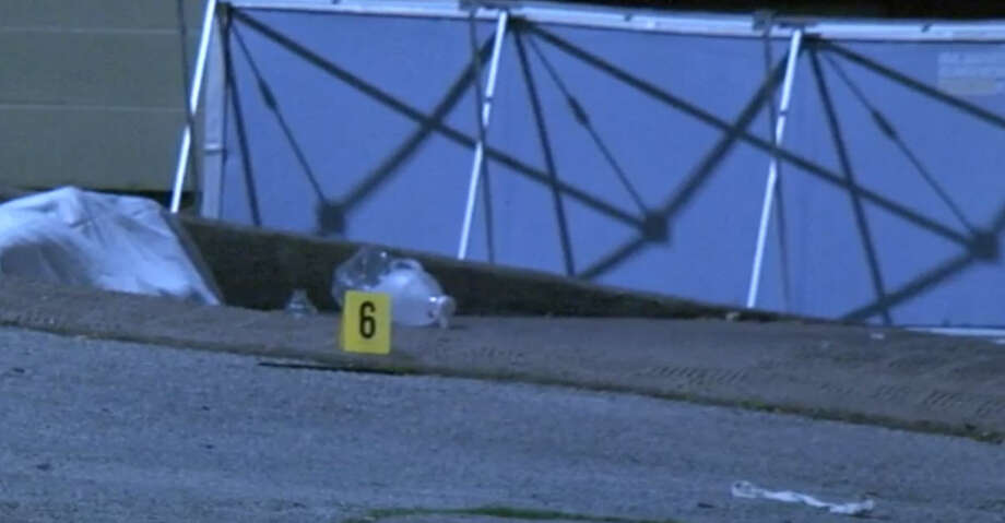 Police are searching for a possible suspect in the killing of a man next to the Falls of Bellaire Apartments in southwest Houston on Saturday night.  At about 7 p.m., one man approached another man sitting outside a convenience store next to the apartment complex, near the intersection of Bellaire and Westbranch, and shot him once at close range. Photo: Metro Video