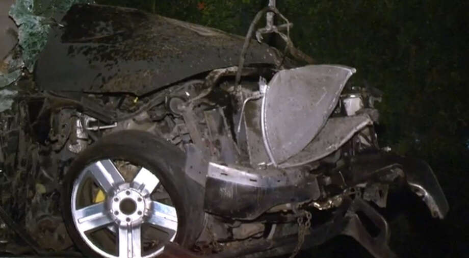 The driver of a black pickup truck was killed Saturday night when he lost control on FM 521 just south of Beltway 8 and struck an electric pole. Photo: Metro Video