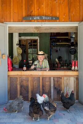Owner Walter Georis with some of their chickens that roam the property at Cowgirl Winery in Carmel Valley, Calif., Friday, August 14, 2015.
