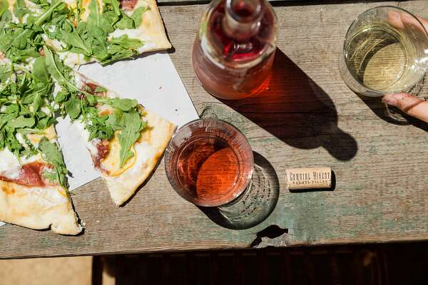 Guests can enjoy a pizza with their wine flight outside at Cowgirl Winery in Carmel Valley, Calif., Friday, August 14, 2015.