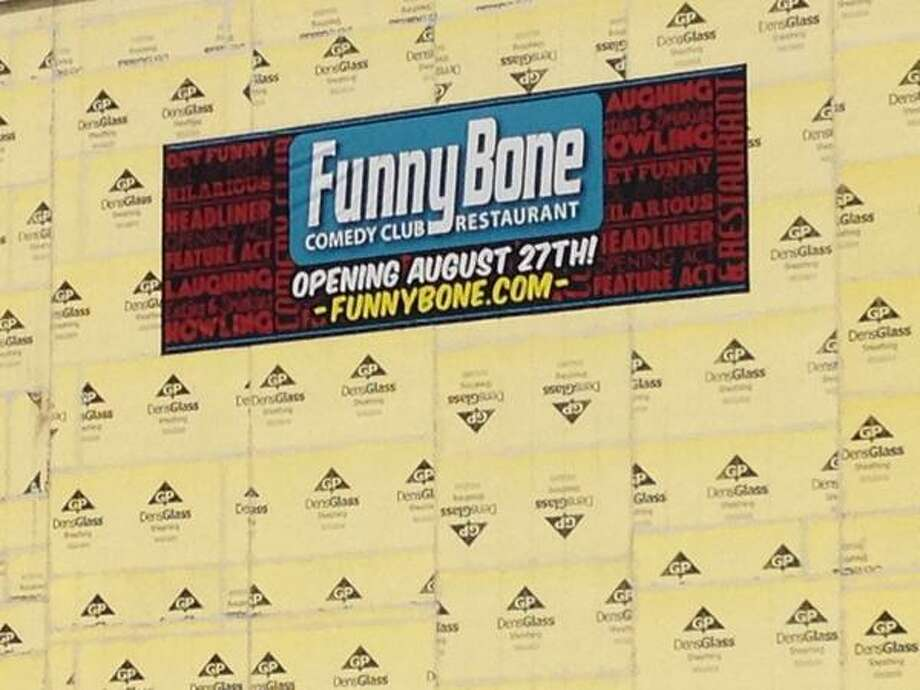 A sign showing on Aug. 16, 2015 that the Funny Bone comedy club will open at Crossgates Mall on Aug. 27, 2015.