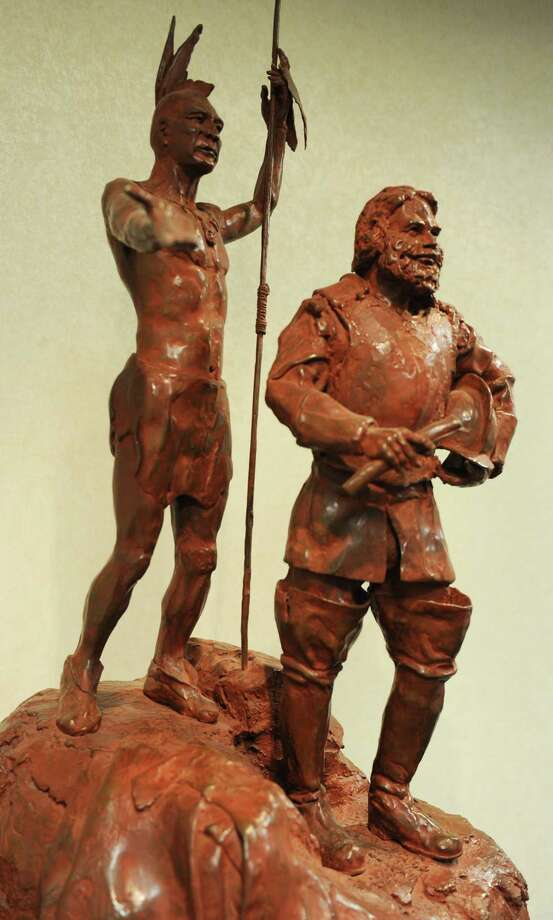 A bronze sculpture depicts Mayn Mayano, chief of the Siwanoy tribe, and Capt. Daniel Patrick of the Massachusetts Militia, transferring the deed for the patch of land that became Greenwich. The sculpture is on the second floor of Greenwich Town Hall. Photo: Tyler Sizemore / File Photo / Greenwich Time