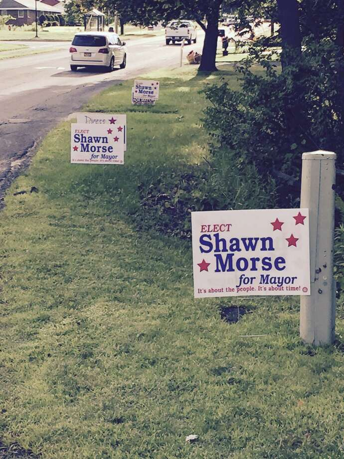 Cohoes councilwoman Dianne Nolin's campaign took a picture of Nolin's campaign signs being obscured by mayoral opponent Shawn Morse signs on Columbia Street Aug. 13, 2015. (provided by Libby Post)