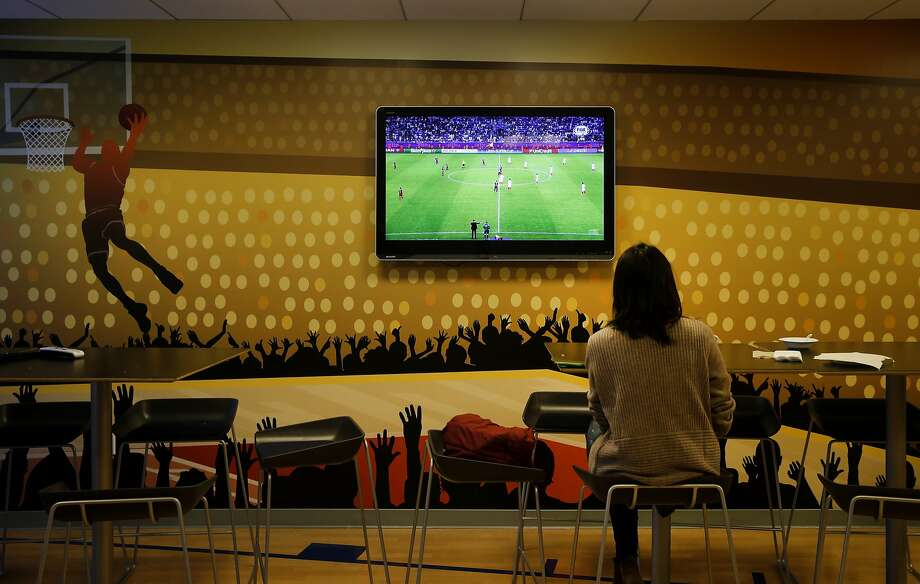 An employee watches a soccer match on television near one of the many kitchen areas at StubHub. The offices of StubHub are off Howard Street in San Francisco, Calif. where they take up several floors over looking the new transit center. Photo: Brant Ward, The Chronicle