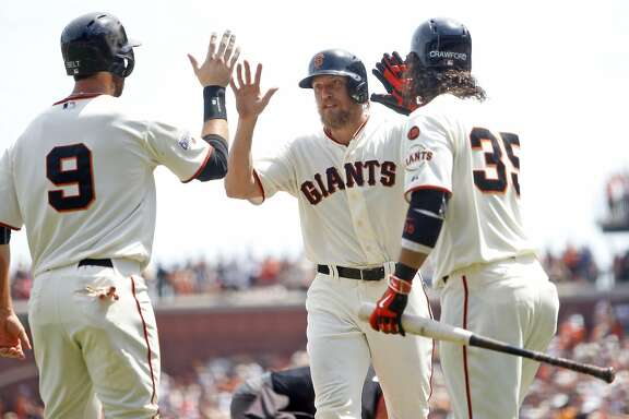 San Francisco Giants' Hunter Pence celebrates his 4th inning 2-run home run off of Washington Nationals' Joe Ross with Brandon belt (9) and Brandon Crawford during MLB game at AT&T Park in San Francisco, Calif., on Sunday, Aug. 16, 2015.