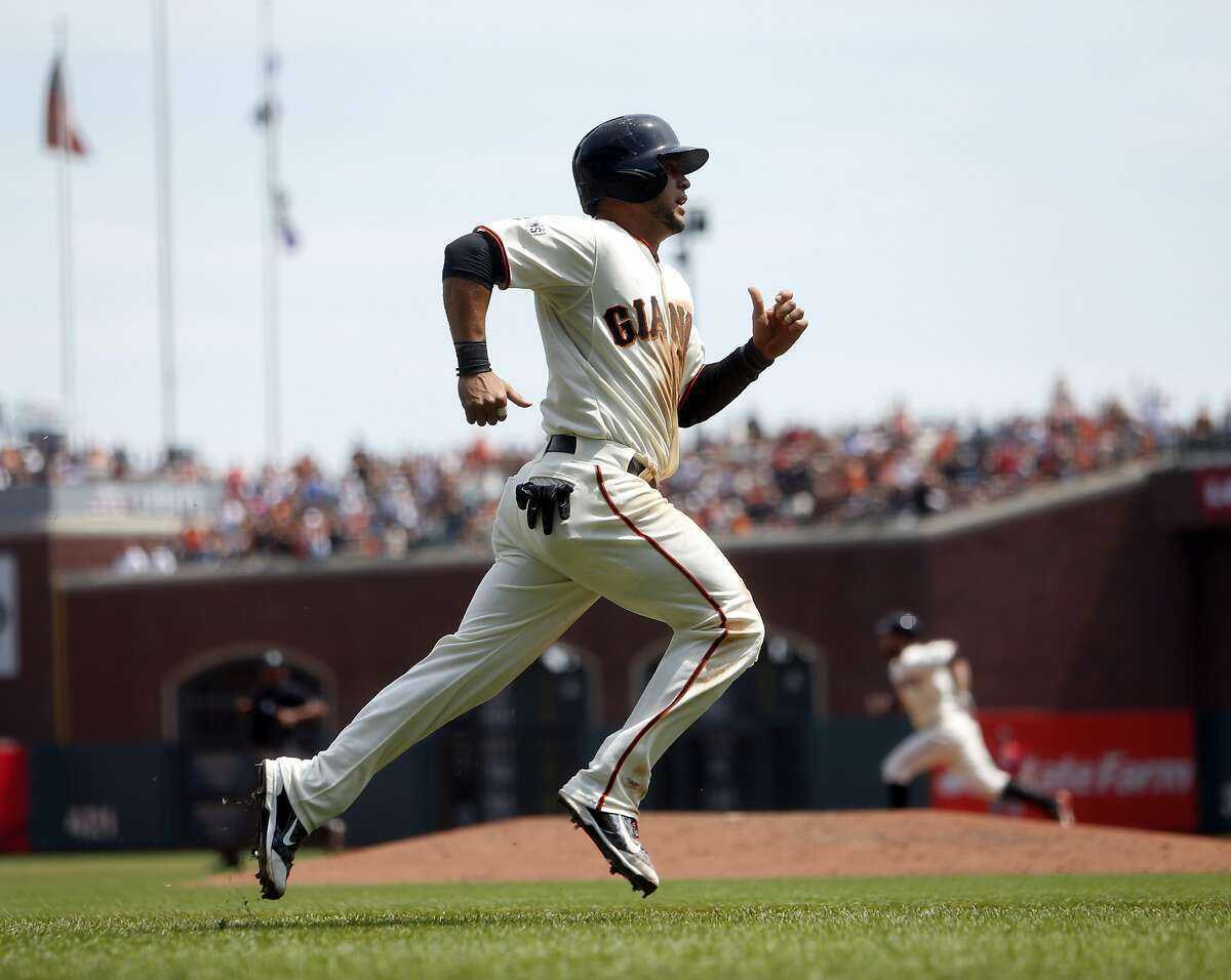 San Francisco Giants' Gregor Blanco scores on Brandon Belt's his RBI double in 4th inning against Washington Nationals during MLB game at AT&T Park in San Francisco, Calif., on Sunday, Aug. 16, 2015.