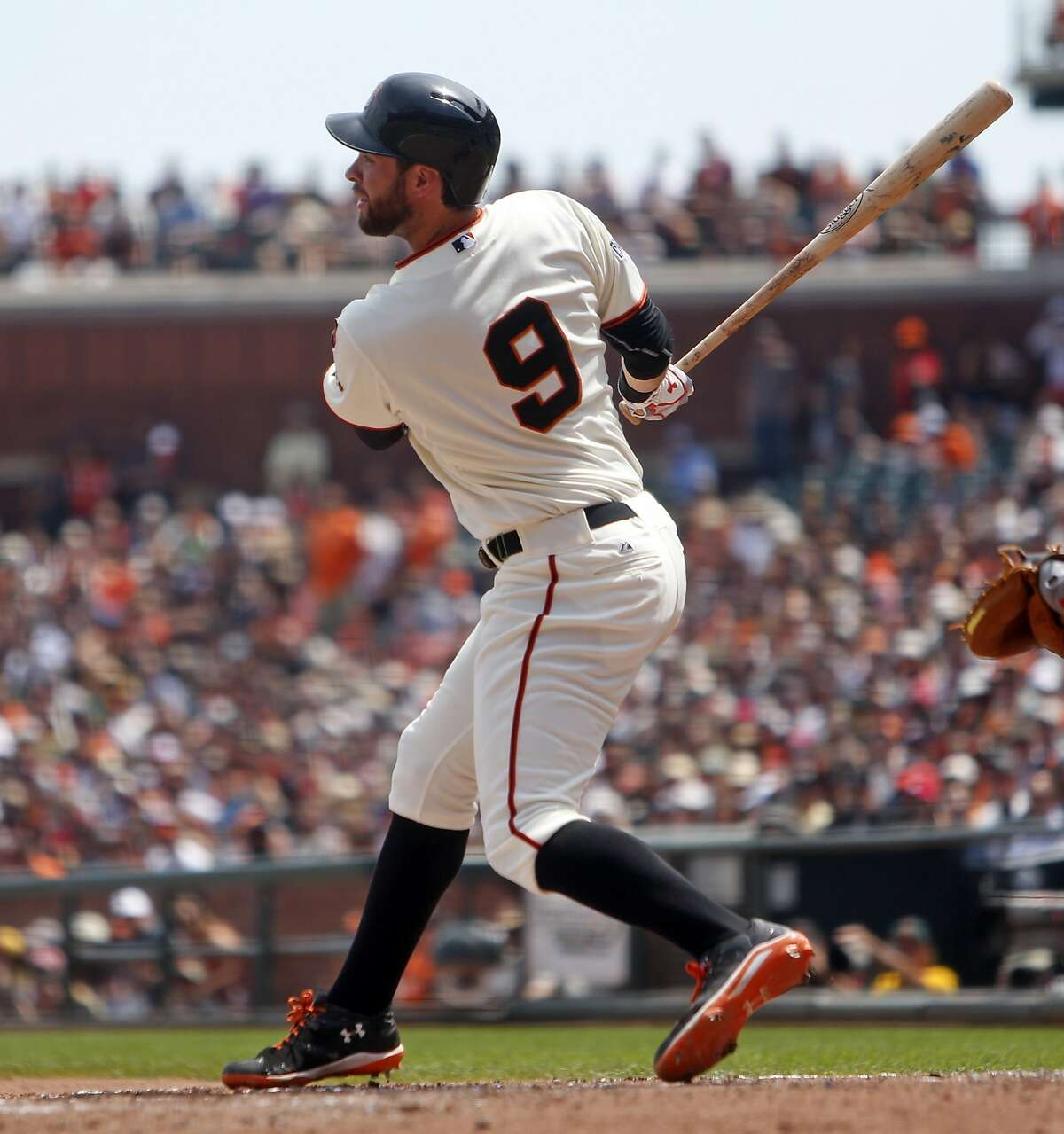 San Francisco Giants' Brandon Belt watches his RBI double in 4th inning against Washington Nationals during MLB game at AT&T Park in San Francisco, Calif., on Sunday, Aug. 16, 2015.