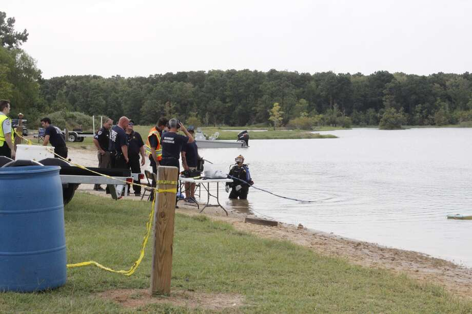 Divers search for a child who drowned at Boomtown USA Sunday afternoon.