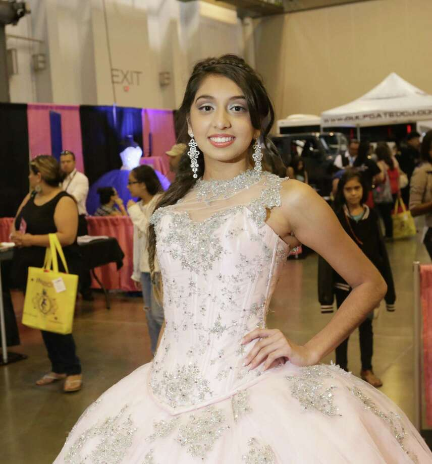 People pose for a photo during the Houston Quinceanera Expo at NRG Center Sunday, Aug. 16, 2015, in Houston. Photo: Jon Shapley, Houston Chronicle / © 2015 Houston Chronicle