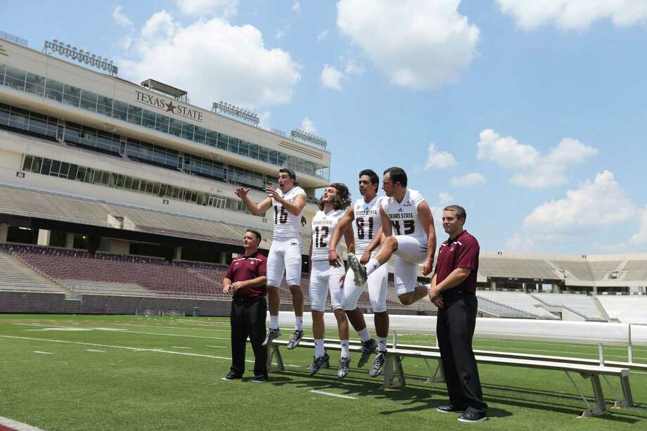 Texas State football assistants Brad Franchione (from left), Jack Rhoades, Lumi Kaba, Inoke Langi, James Sherman, and Kyle Robinson joke while posing for photos during media day on Aug. 16, 2015 at Bobcat Stadium in San Marcos. Photo: Edward A. Ornelas /San Antonio Express-News / © 2015 San Antonio Express-News