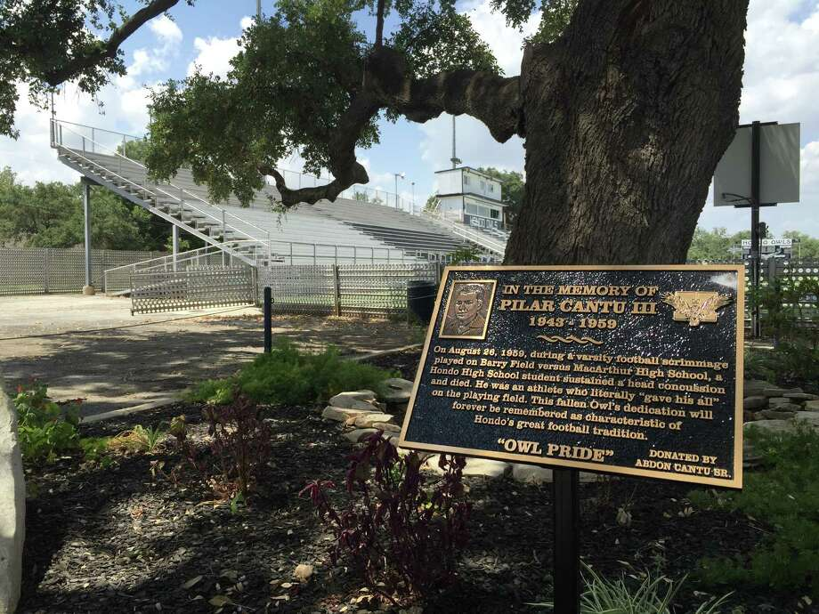 This new plaque, at the entrance of Barry Field, commemorates deceased Hondo Owl player Pilar Cantu III, who died following a head injury suffered in a 1959 scrimmage against MacArthur. Photo: Roy Bragg /San Antonio Express-News / © 2015 San Antonio Express-News