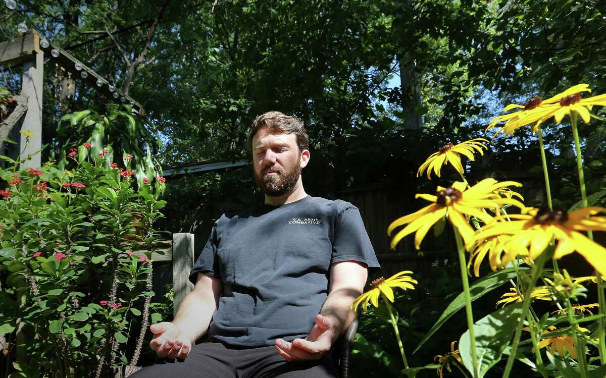 Iraq War veteran Tom Voss practices meditation in his garden. He discovered meditation during a journey filmed for the documentary