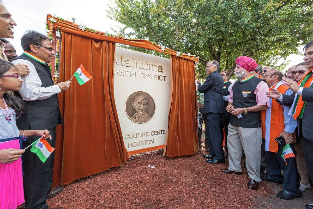 P. Harish, counsel general of India based in Houston, unveils a monument recognizing the Mahatma Gandhi District at a ceremony Sunday.