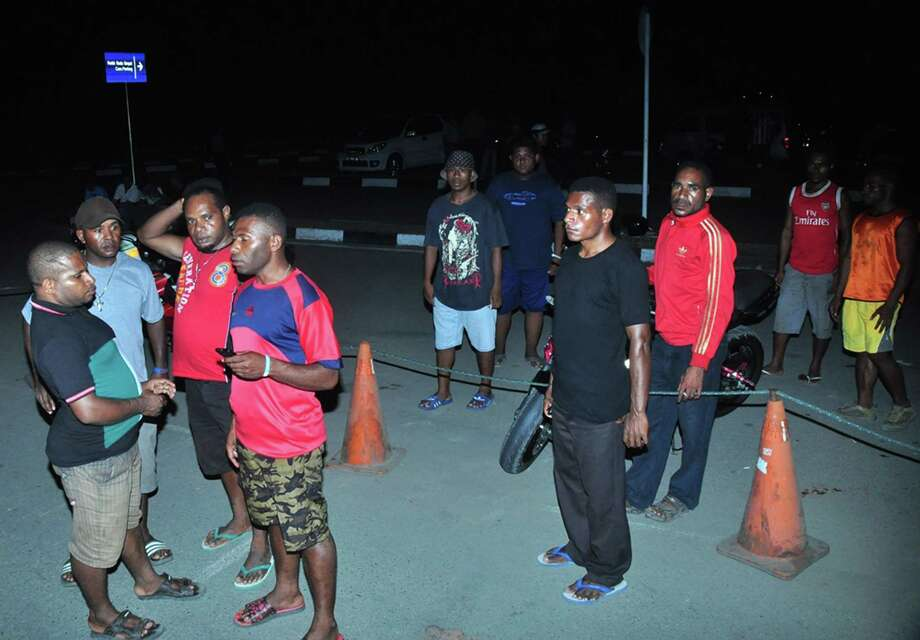 Relatives of passengers of a crashed passenger plane wait for news at Jayapura Airport in the eastern Indonesian province of Papua on August 16, 2015. Indonesia's transport ministry have announced that a missing plane carrying 54 people has crashed into a mountain in eastern Indonesian province of Papua. A passenger plane of Trigana Air carrying 54 people went missing on August 16 during a flight in bad weather in rugged eastern Indonesia, officials said, in what could be the latest accident to hit the country's aviation sector.  AFP PHOTO / INDRAYADIINDRAYADI/AFP/Getty Images Photo: INDRAYADI, Stringer / AFP / Getty Images / AFP