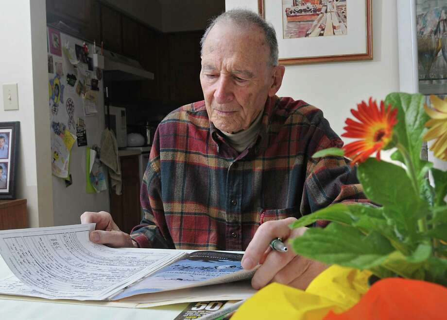 Paul Elisha sits at his dining room table where he does some of his work in Niskayuna, NY on November 5, 2010. Paul is a World War ll veteran who is grand marshal of the Veterans Day parade in Albany. He is writing his memoirs.  (Lori Van Buren / Times Union) Photo: Lori Van Buren / 00010955A