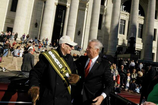 Mayor Jerry Jennings,right, greets WWII Veteran and parade grand marshall Paul Elisha of Niskayuna during the Annual Albany Veterns Day parade on Wasington Avenue in Albany 11/11/2010. ( Michael P. Farrell/Times Union ) Photo: Michael P. Farrell / 10011024A
