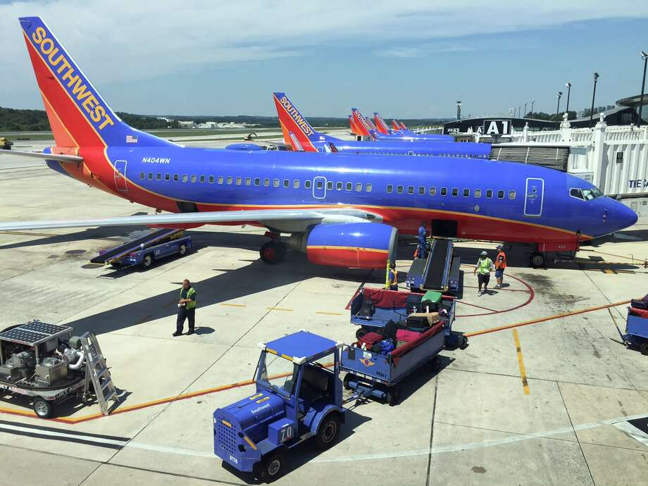 BALTIMORE, MD - AUGUST 15:  Southwest Airlines planes sit at their gates at Baltimore-Washington International Airport  as flights are delayed due to technical issues at a Federal Aviation Administration center August 15, 2015 in Baltimore, Maryland. The FAA is investigating an automation problem with flight tracking at a center in Virginia that has caused delays in flight arrivals and departures in the Washington and New York City regions.  (Photo by Rob Carr/Getty Images) ORG XMIT: 570708379 Photo: Rob Carr / 2015 Getty Images