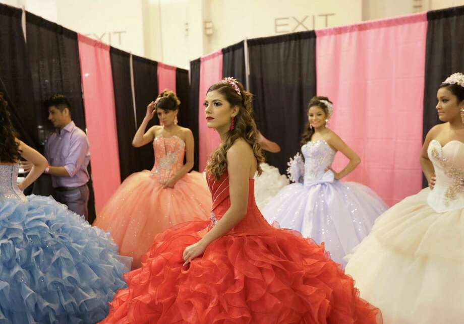 Aleida Gonzalez prepares with models backstage before performing Sunday at the Houston Quinceanera Expo at NRG Center. Photo: Jon Shapley, Staff / © 2015 Houston Chronicle