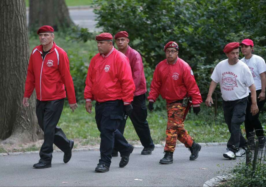 Guardian Angels founder Curtis Sliwa leads members of the Guardian Angles through Central Park  Wednesday, Aug. 12, 2015, in New York. Guardian Angels volunteers made a return this month to Central Park for the first time in over two decades, citing a 26 percent rise in crime there so far this year. (AP Photo/Frank Franklin II) ORG XMIT: NYFF104 Photo: Frank Franklin II / AP