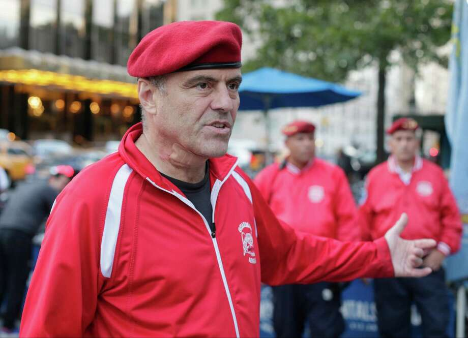 Guardian Angels founder Curtis Sliwa responds to questions during a news interview Wednesday, Aug. 12, 2015, in New York. Guardian Angels volunteers made a return this month to Central Park for the first time in over two decades, citing a 26 percent rise in crime there so far this year. (AP Photo/Frank Franklin II) ORG XMIT: NYFF102 Photo: Frank Franklin II / AP