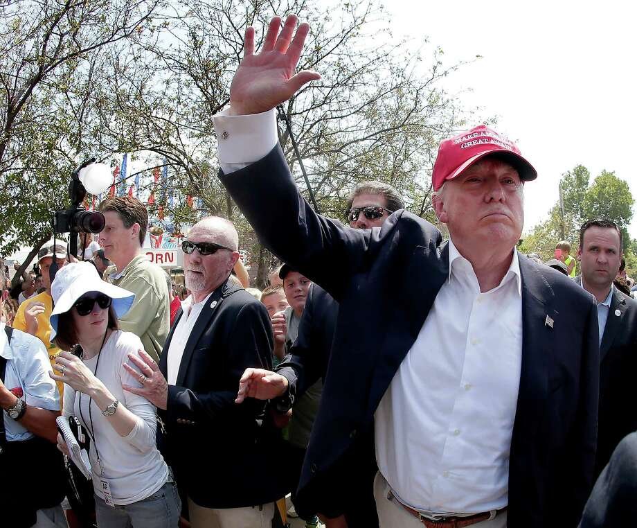 Republican presidential candidate Donald Trump waves to the crowd at the Iowa State Fair Saturday, Aug. 15, 2015, in Des Moines. (AP Photo/Charlie Riedel) ORG XMIT: IACR120 Photo: Charlie Riedel / AP