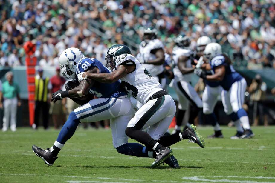 Indianapolis Colts' Andre Johnson (81) tries to slip free of Philadelphia Eagles' Nolan Carroll (23) during the first half of a preseason NFL football game, Sunday, Aug. 16, 2015, in Philadelphia. (AP Photo/Matt Rourke) Photo: Matt Rourke, STF / AP