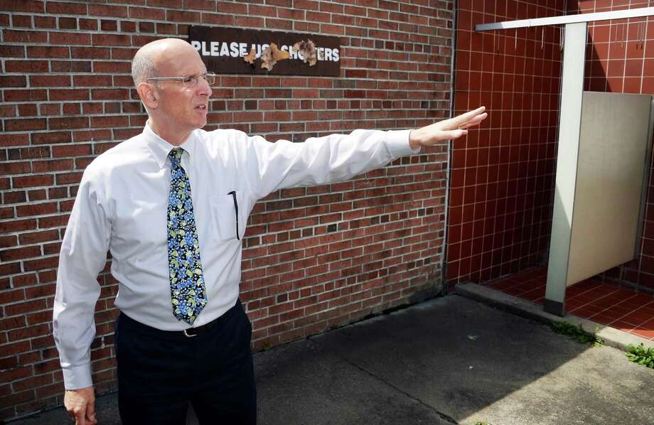 Saratoga Springs attorney Kurt Mausert points out poor conditions in the men's shower room at Peerless Pool at Saratoga Spa State Park Wednesday August 12, 2015 in Saratoga Springs, NY.  (John Carl D'Annibale / Times Union) Photo: John Carl D'Annibale / 00032983A