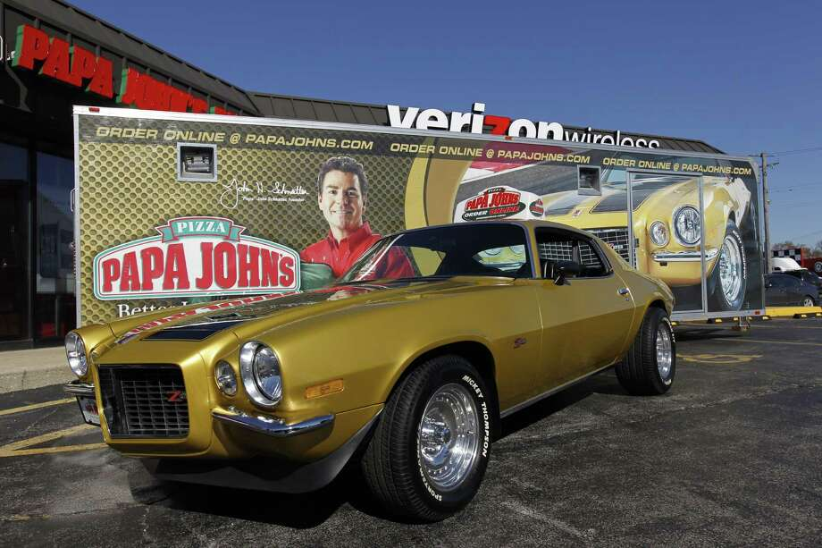 FILE - In this Monday, Oct. 24, 2011, file photo, Papa John's Founder, Chairman, and CEO John Schnatter's 1971 Chevy Camaro is shown at the Papa John's 3000th North American Store Celebration in Burbank, Ill. Officials say the Camaro is among three vehicles stolen during a Detroit-area event showcasing classic cars on Sunday, Aug. 16, 2015. (Ross Dettman/AP Images for Papa John's, File) Photo: Ross Dettman, AP / AP Images