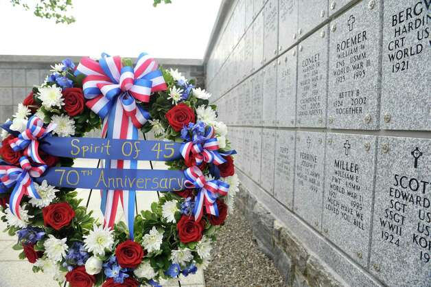A memorial wreath is seen during a Spirit of O45 Ceremony at the Gerald B. H. Solomon Saratoga National Cemetery on Sunday, Aug. 16, 2015, in Schuylerville, N.Y.  The event was held to honor WWII Veterans and the end of WWII.  (Paul Buckowski / Times Union) Photo: PAUL BUCKOWSKI / 00032965A