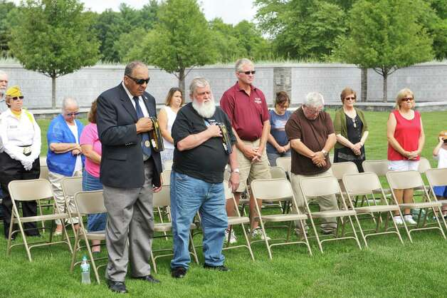 People take part in a prayer during a Spirit of O45 Ceremony at the Gerald B. H. Solomon Saratoga National Cemetery on Sunday, Aug. 16, 2015, in Schuylerville, N.Y.  The event was held to honor WWII Veterans and the end of WWII.  (Paul Buckowski / Times Union) Photo: PAUL BUCKOWSKI / 00032965A