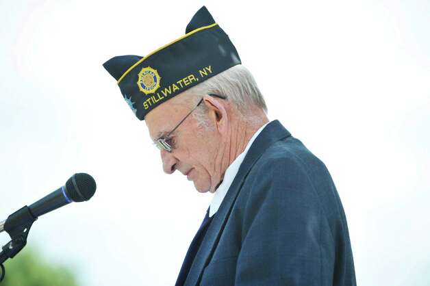 Veteran John Mehan of Stillwater talks about six relatives that served during World War II during a Spirit of O45 Ceremony at the Gerald B. H. Solomon Saratoga National Cemetery on Sunday, Aug. 16, 2015, in Schuylerville, N.Y.  The event was held to honor WWII Veterans and the end of WWII.  Mehan, a veteran of the Air Force, is also the chairman of the National Saratoga Support Committee for the cemetery.  (Paul Buckowski / Times Union) Photo: PAUL BUCKOWSKI / 00032965A