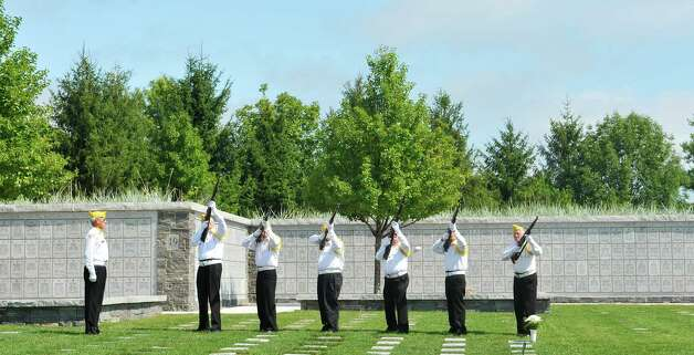 Volunteer members of the Saratoga National Cemetery Honor Guard Association give a rifle salute during a Spirit of O45 Ceremony at the Gerald B. H. Solomon Saratoga National Cemetery on Sunday, Aug. 16, 2015, in Schuylerville, N.Y.  The event was held to honor WWII Veterans and the end of WWII.  (Paul Buckowski / Times Union) Photo: PAUL BUCKOWSKI / 00032965A