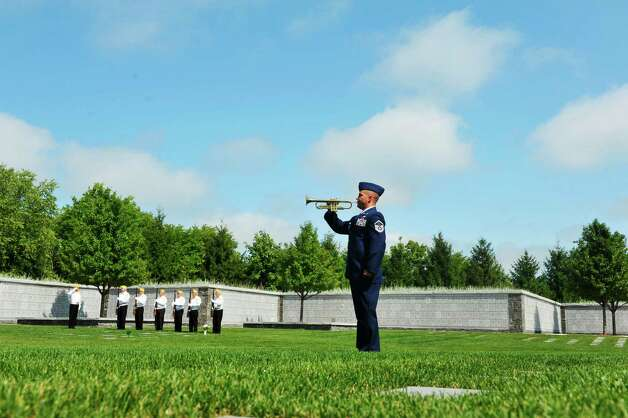 Air National Guard Master Sergeant Allen Moon, with the 109th Airlift Wing, plays Taps during a Spirit of O45 Ceremony at the Gerald B. H. Solomon Saratoga National Cemetery on Sunday, Aug. 16, 2015, in Schuylerville, N.Y.  The event was held to honor WWII Veterans and the end of WWII.  (Paul Buckowski / Times Union) Photo: PAUL BUCKOWSKI / 00032965A