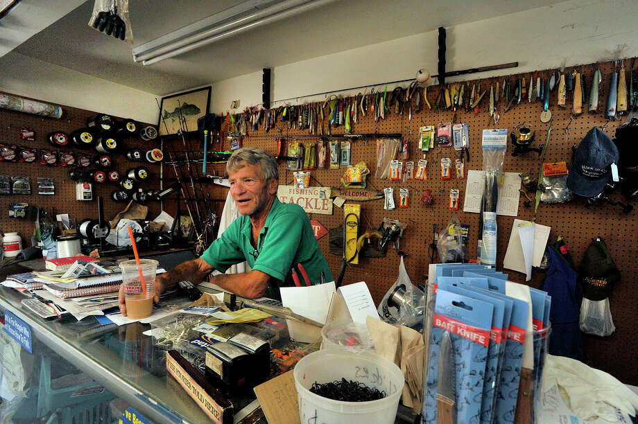 Owner Pete Miller sits behind the counter awaiting customers at Pete's Place, a tackle and bait shop, in Stamford. Photo: Jason Rearick / Hearst Connecticut Media / Stamford Advocate