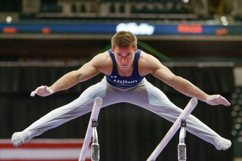 Three-time champion Sam Mikulak ran away with the men's all-around title, finishing a distant 4.3 points ahead of second place. Photo: AJ Mast, FRE / FR123854 AP