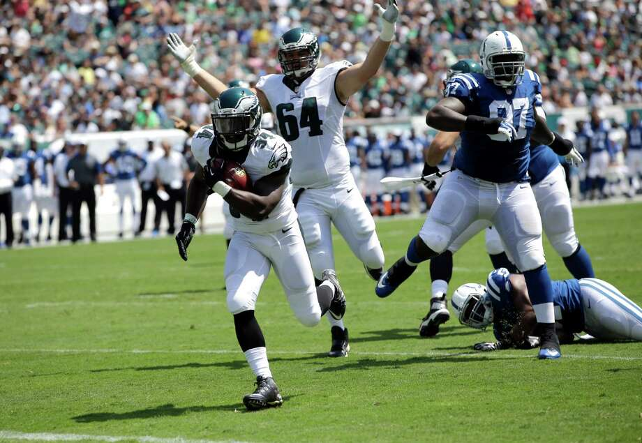 Philadelphia Eagles' Kenjon Barner (34) scores a touchdown during the first half of a preseason NFL football game against the Indianapolis Colts, Sunday, Aug. 16, 2015, in Philadelphia. (AP Photo/Michael Perez) ORG XMIT: PXE107 Photo: Michael Perez / FR168006 AP