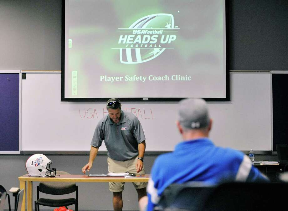 Ken Stoldt, a master trainer with USA Football, runs through a USA Football's Heads Up Football Player Safety Clinic on Sunday, Aug. 16, 2015, at Christian Brothers Academy in Colonie, N.Y.  (Paul Buckowski / Times Union) Photo: PAUL BUCKOWSKI / 00033026A