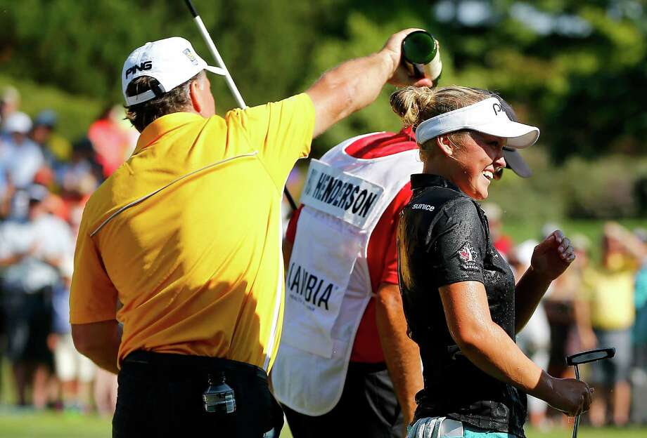 While she is too young to legally drink, there is no law that prevents 17-year-old Brooke Henderson from being showered with bubbly on the 18th green after the Canadian teen romped to victory in the LPGA Cambia Portland Classic on Sunday. Photo: Jonathan Ferrey, Stringer / 2015 Getty Images