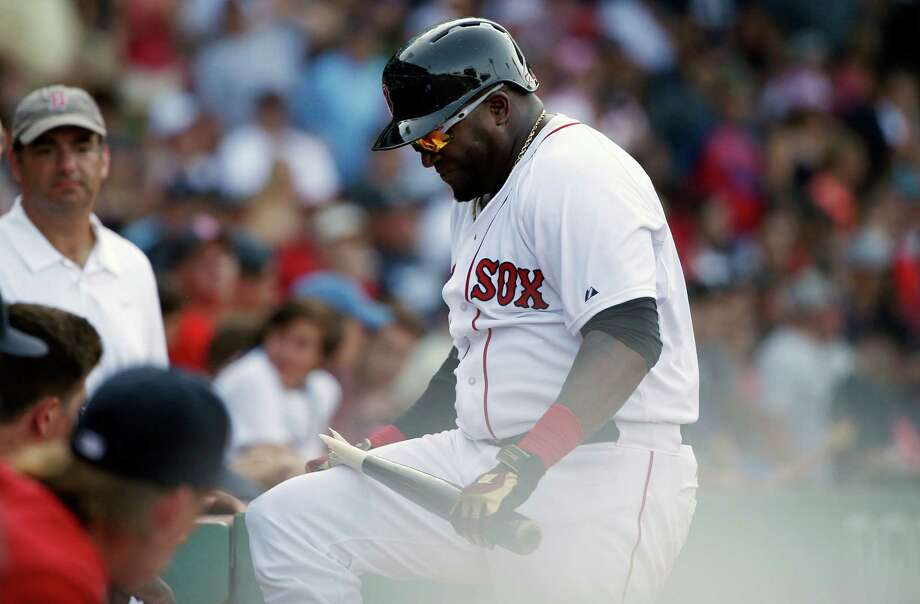 Boston Red Sox's David Ortiz breaks his bat over his knee after striking out during the eleventh inning of a baseball gamea gainst the Seattle Mariners in Boston, Sunday, Aug. 16, 2015. (AP Photo/Michael Dwyer) ORG XMIT: MAMD111 Photo: Michael Dwyer / AP