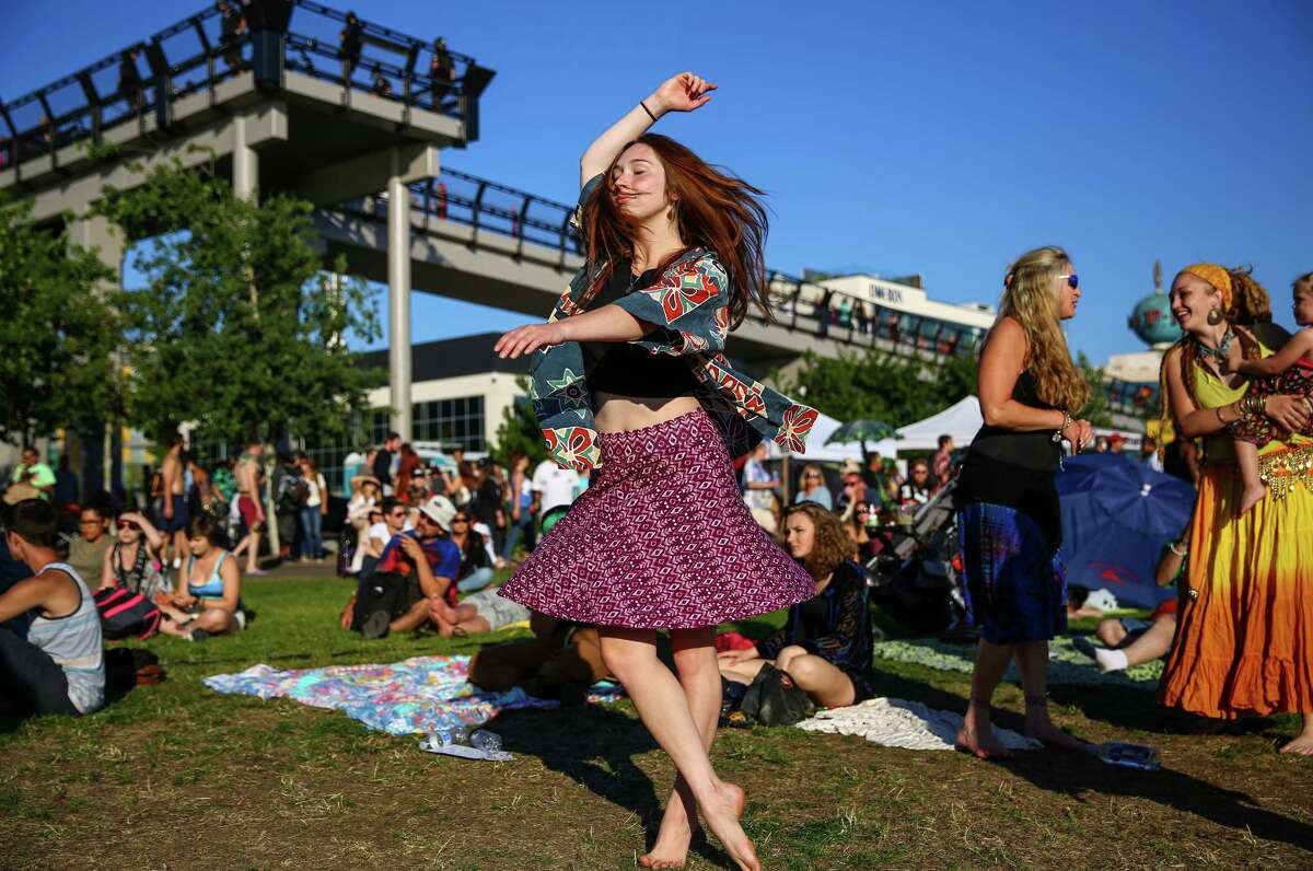 A participant dances during Hempfest, the annual cannabis freedom festival at Myrtle Edwards Park on the Seattle waterfront. The three day festival is an annual Seattle tradition that started in 1991. Photographed on Sunday, August 16, 2015.